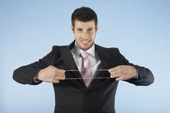 Businessman Stretching Rubber Band Royalty Free Stock Photos