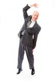Businessman stretching and smiling Stock Photo
