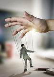 Businessman On Strings. Conceptual photography Stock Images