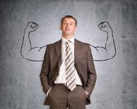 Businessman with strong arms drawn in pencil Stock Photo