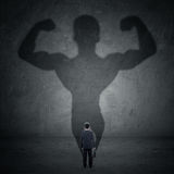 Businessman and strong shadow 5 Royalty Free Stock Photography