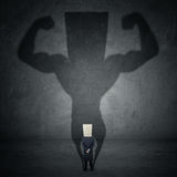 Businessman and strong shadow Royalty Free Stock Photos