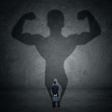 Businessman and strong shadow 1 Royalty Free Stock Photo