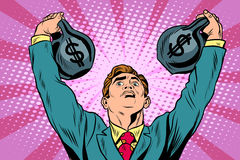 Businessman strongman lifts weights money Royalty Free Stock Photography