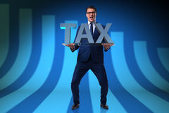 The businessman struggling with high taxes Royalty Free Stock Photography