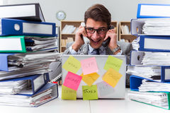The businessman struggling with multiple priorities Royalty Free Stock Photos