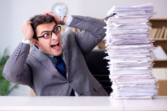 The businessman struggling to meet challenging deadlines Royalty Free Stock Photo