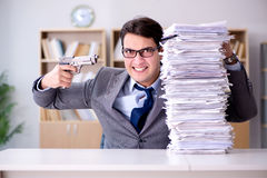 The businessman struggling to meet challenging deadlines Royalty Free Stock Photography