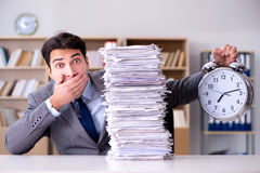 The businessman struggling to meet challenging deadlines Royalty Free Stock Photos