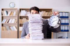 The businessman struggling to meet challenging deadlines Stock Images
