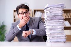 The businessman struggling to meet challenging deadlines Stock Photography