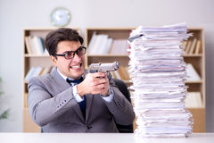 The businessman struggling to meet challenging deadlines Stock Image
