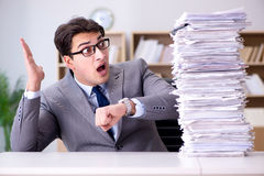 The businessman struggling to meet challenging deadlines Royalty Free Stock Images