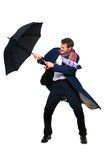 Businessman struggling with umbrella Royalty Free Stock Images