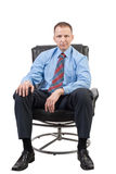 Businessman stting in armchair Royalty Free Stock Photography