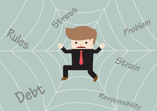 Businessman stuck on spider web Stock Photo