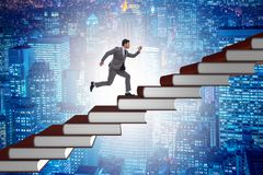 The businessman student climbing the ladder of education books. Businessman student climbing the ladder of education books Stock Image