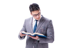 The businessman student reading a book isolated on white background. Businessman student reading a book isolated on white background Royalty Free Stock Photo