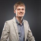 Businessman  studio portrait on gray Stock Image