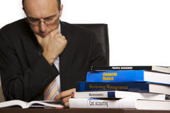 Businessman studying books Stock Photo