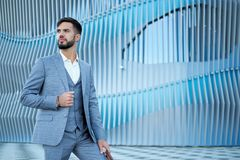 Businessman style. Men style. Man in custom tailored business suit posing outdoors.  stock photography