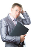 Businessman in stylish suit keeps laptop Stock Image