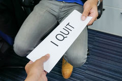 Businessman submit resignation letter to boss. Businessman submit a resignation letter to boss Stock Photo