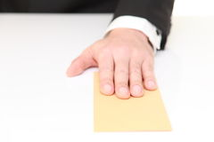 Businessman submits an envelope Royalty Free Stock Images