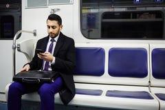 Businessman on Subway train stock image