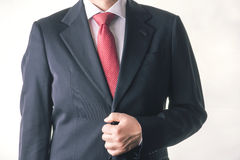 Businessman. Successful business man buttoning his suit Royalty Free Stock Images