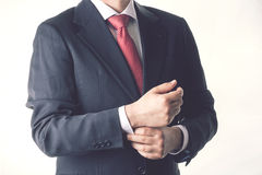 Businessman. Successful business man buttoning his suit Royalty Free Stock Image