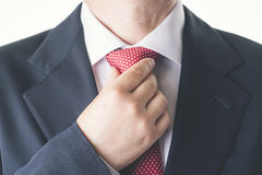 Businessman. Successful business man buttoning his tie Royalty Free Stock Photos