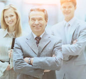 Businessman and successful business team at the office looking  the camera  smiling Royalty Free Stock Photos