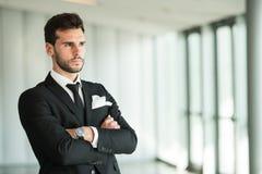 Businessman. A successful businessman portait in a office stock photo
