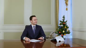 Businessman successfully finishes work with documents and walk away for a christmas holidays. Professional shot in 4K resolution. 055. You can use it e.g. in stock video