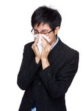 Businessman suffer from runny nose Stock Photo