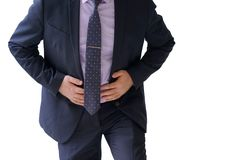 Businessman suffering from abdominal pain. Businessman holding his stomach in pain isolated on a white background Stock Images