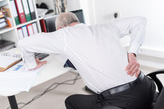 Businessman suffering from back pain Royalty Free Stock Image