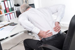 Businessman suffering from back pain Stock Photo