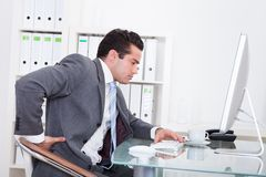 Businessman suffering from back pain Royalty Free Stock Photos