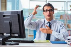 The businessman suffering from excessive armpit sweating. Businessman suffering from excessive armpit sweating Royalty Free Stock Photo