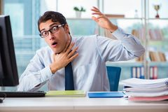 The businessman suffering from excessive armpit sweating. Businessman suffering from excessive armpit sweating Stock Photo