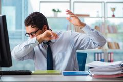 The businessman suffering from excessive armpit sweating. Businessman suffering from excessive armpit sweating Royalty Free Stock Photos