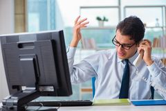 The businessman suffering from excessive armpit sweating. Businessman suffering from excessive armpit sweating Stock Photos