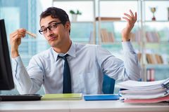The businessman suffering from excessive armpit sweating. Businessman suffering from excessive armpit sweating Stock Photography