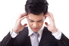 Businessman suffering from headache studio isolated Royalty Free Stock Image