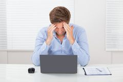 Businessman suffering from headache Royalty Free Stock Photo