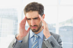Businessman suffering from a headache Stock Photography