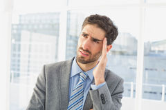 Businessman suffering from a headache Stock Photo