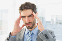Businessman suffering from a headache Stock Image